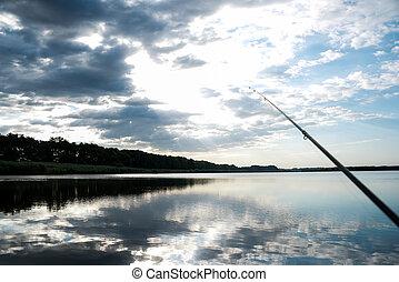 Fishing on sunrise is reflected