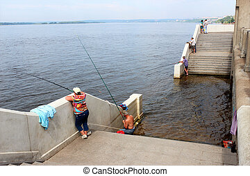 Fishing on the seafront in the spring flood season.