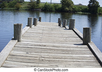 A fishing pier jutting out into a lake