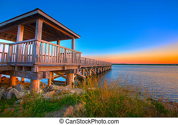 Fishing Pier Against a Colorful Dawn Sky.