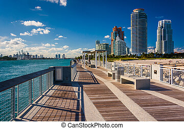 Fishing pier at South Pointe Park and view of skyscrapers in Mia