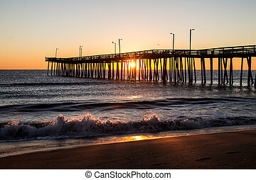 Fishing Pier at Sunrise with Waves