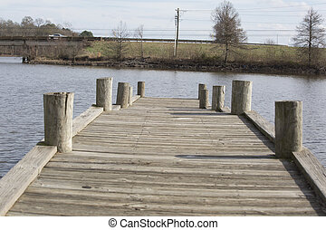 Close up of a fishing pier on a lake