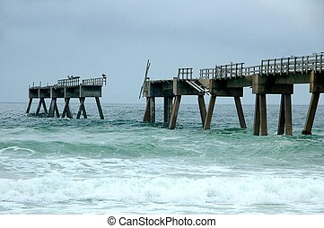 photographed fishing pier damaged after hurricane on the Gulf of Mexico Florida.