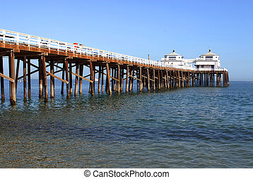 famous Malibu Pier, California on a sunny, cloudless day