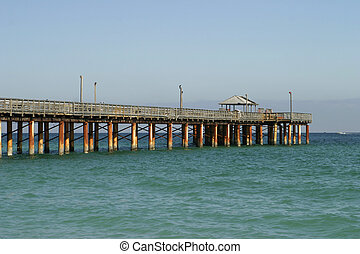 The fishing pier in Sunny Isles Beach (Florida) extends a long way into the ocean.
