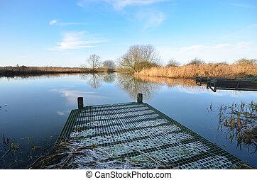 fishing platform jutting in river