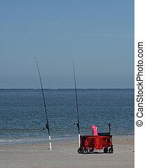 Fishing poles on Fernandina Beach, Cumberland Sound, Fort Clinch State Park, Nassau County, Florida USA