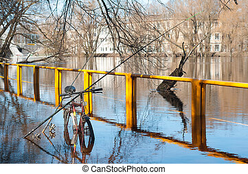 Fishing poles relied on bicycle in flooded river