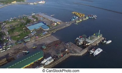 Fishing port and dock yard where boats are anchored side by...