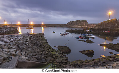 fishing port to the sunset with reflections in the sea