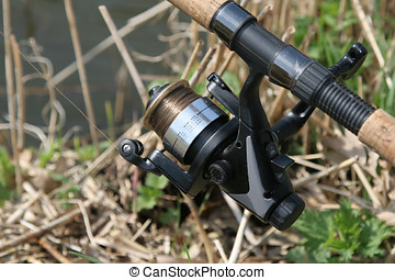 Fishing reel - Closeup of fishing reel outdoors
