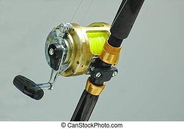 Photographed a big game fishing reel from a charter fishing boat in Florida. Resubmitted after changes for dust.