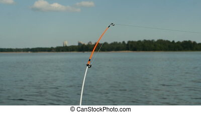 fishing rod big game - fishing rod on the background of the...