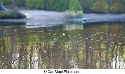 fishing rod on a background of the autumn river