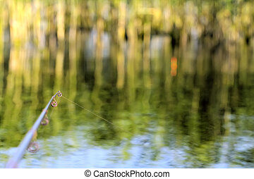 fishing rod river angling with float - fishing rod in creeks...