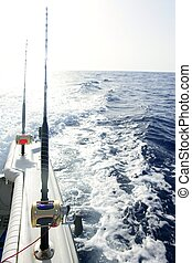 Fishing rods in a big game saltwater boat during fishery day
