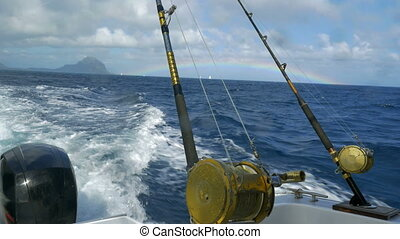 Fishing rods on sailing motor boat - Sailing motor boat with...