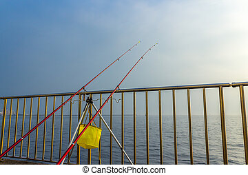 Fishing rods on the water.