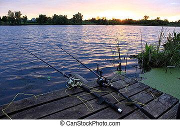 Fishing rods on the wooden bridge