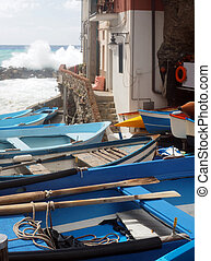 fishing row boats on land during rough sea Rio Marriore Cinque Terre Italy Europe