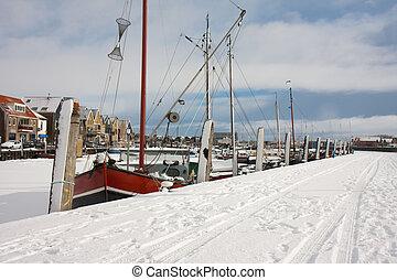 Fishing ship in frozen harbor