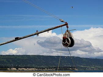 Fishing ship pulley with clouds