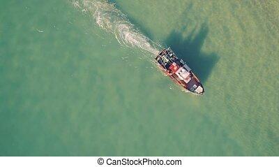 Fishing Ship Uses Trawl for Fishing, aerial view