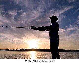 Fishing Sihouette - Man fishing in sunset