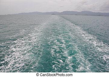 Fishing speed boat prop wash, white wake on ocean