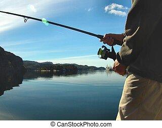 Fishing - Boy fishing by the ocean