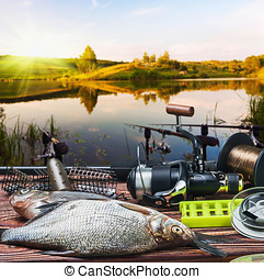 fishing tackle and caught fish on the table