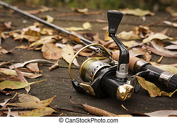 Fishing tackle on wooden surface. - Fishing tackle on wooden...