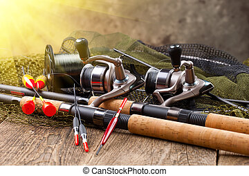 fishing tackles - fishing gear laid out on an old background...