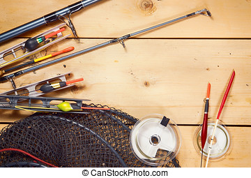 Fishing tackles on wooden background