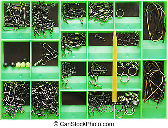fishing tools in a green box