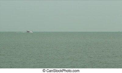 Fishing Trawler in Hazy Sea - footage of a fishing trawler...