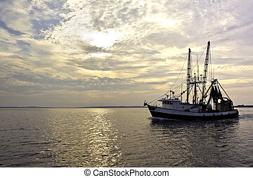 Fishing trawler on the water at sunrise - Fishing trawler on...
