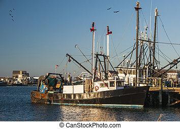 A fishing vessel docked in Montauk Harbor