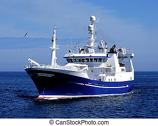Fishing Vessel underway to fishing harbour to land fish.