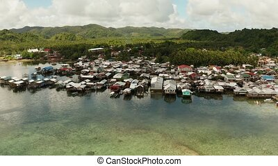 Fishing village and houses on stilts. Dapa city, Siargao, ...