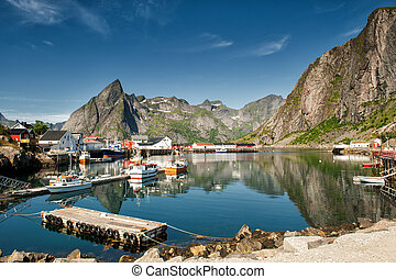 Fishing harbor at Hamnoya in Lofoten. Hamnoya is an idyllic fishing village and a popular travel destination in northern Norway.