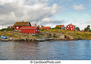 Typical red houses on island in Stockholm archipelago.