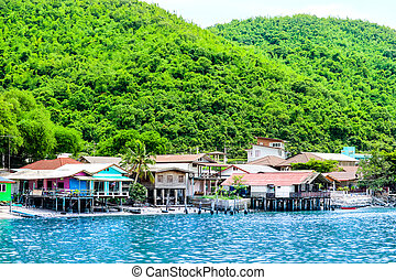 Fishing village on coast The green hills and crystal clear water