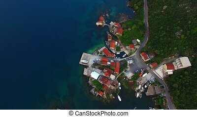 Fishing village on the shore of the peninsula Lushtitsa, in the