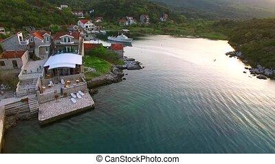 Fishing village on the shore of the peninsula Lushtitsa, in...