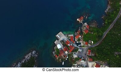 Fishing village on the shore of the peninsula Lushtitsa
