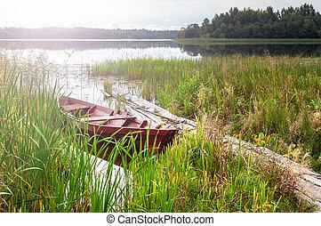 Fishing wooden boat at the lake