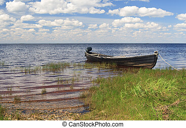 Fishing wooden boat in Lache lake, north Russia