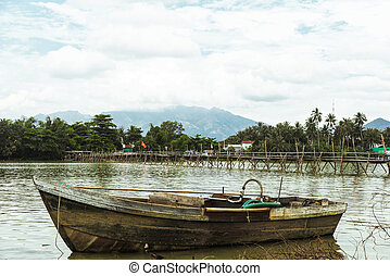 Fishing wooden boat on a river